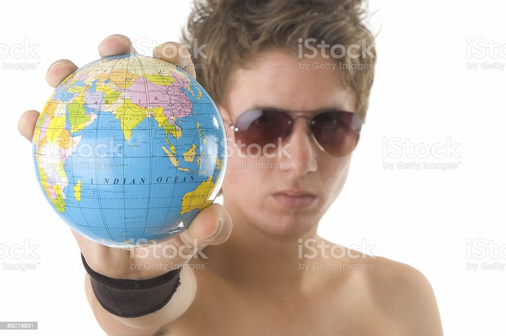 young man and globe stock photo