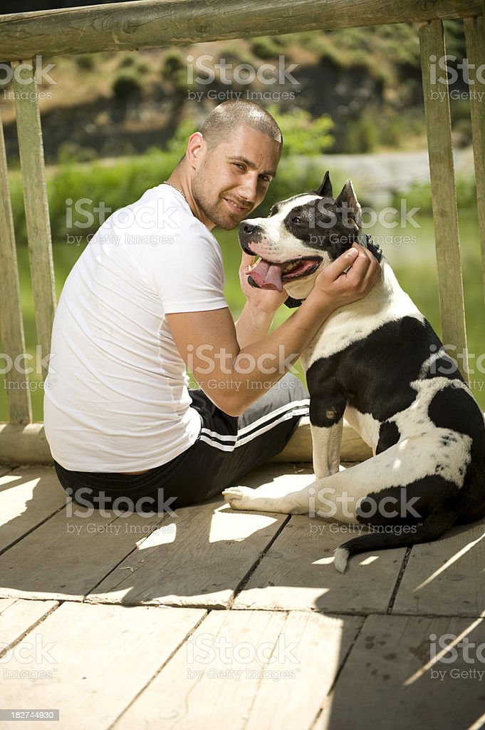 Young Man and His Dog royalty-free stock photo