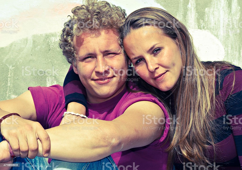 Young man and his girlfriend - toned image royalty-free stock photo