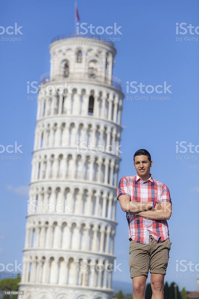 Young Man and Leaning Tower of Pisa stock photo