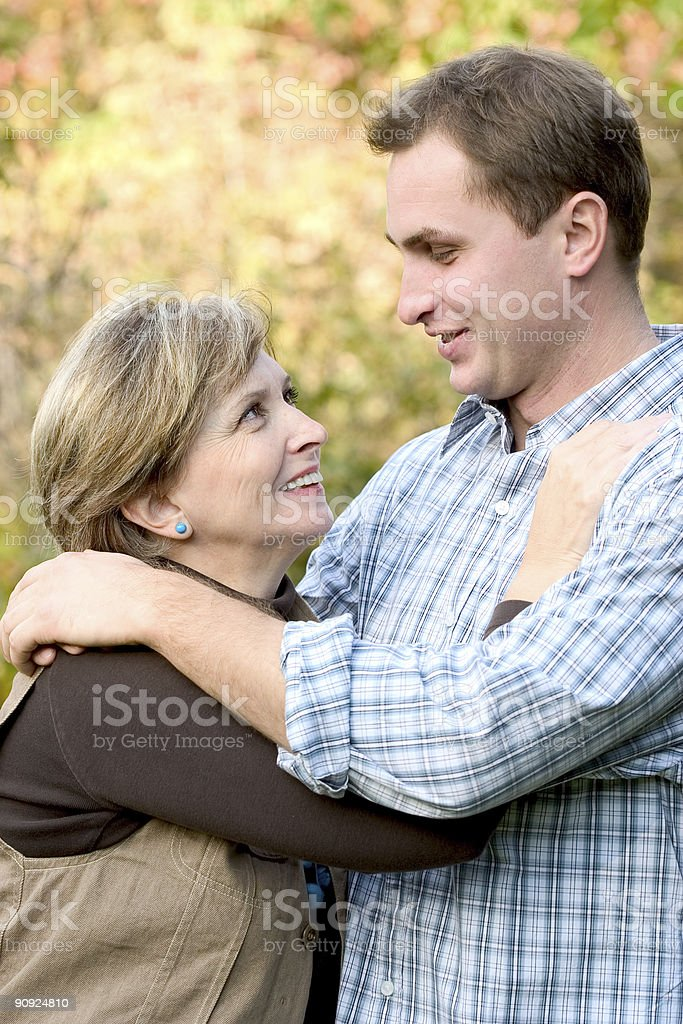 Young man and mature woman royalty-free stock photo