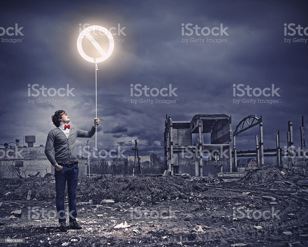 Young man and stop sign royalty-free stock photo