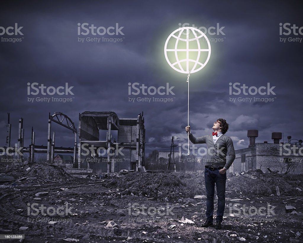 Young man and the symbol of our planet royalty-free stock photo