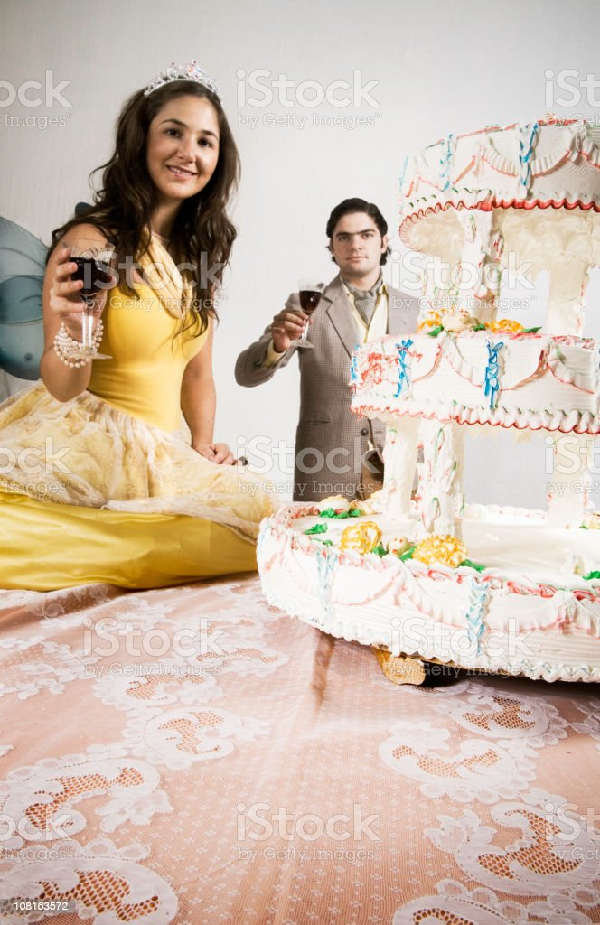 Young Man and Woman Celebrating Birthday with Cake stock photo