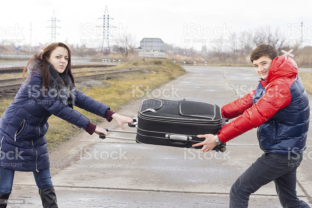 Young man and woman fighting stock photo