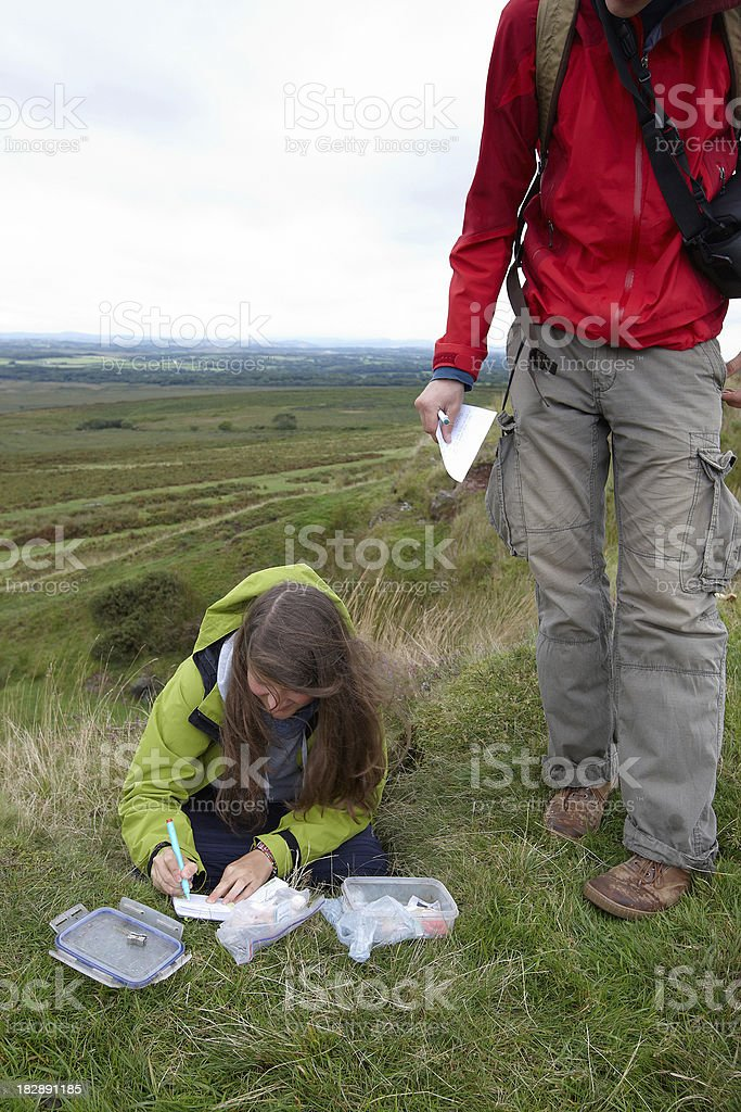 Young man and woman geocaching stock photo