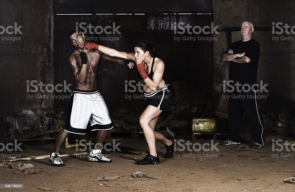 Young Man and Woman in Boxing Match stock photo