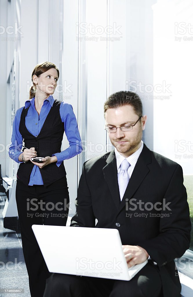 Young man and woman in business meeting royalty-free stock photo