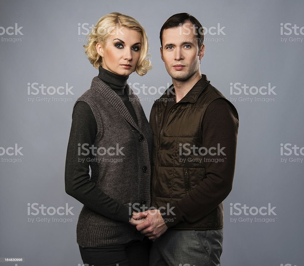 Young man and woman in casual brown wear royalty-free stock photo