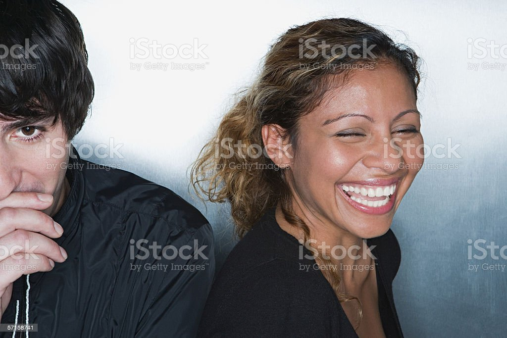 Young man and woman laughing stock photo