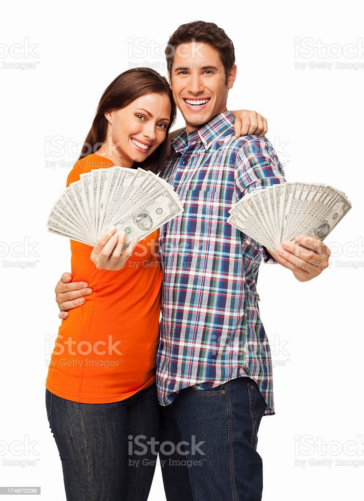 A young man and woman posing while holding fans of money royalty-free stock photo