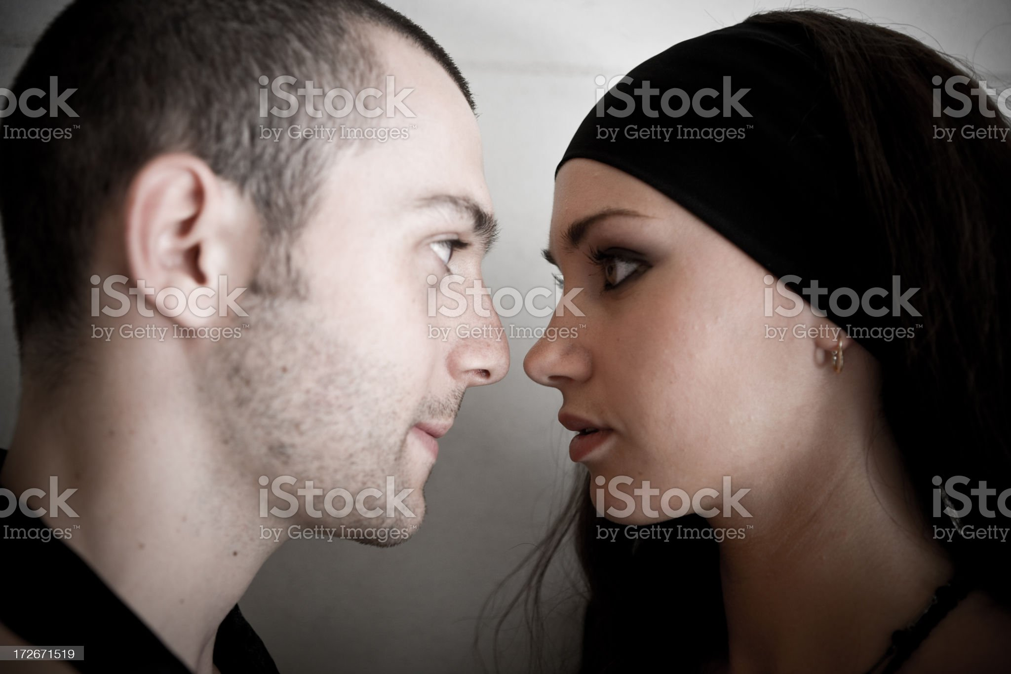 Young Man and Woman Staring at Each Other royalty-free stock photo