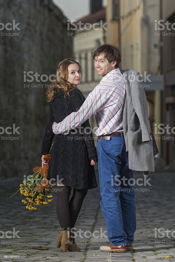 young man and woman walking away together royalty-free stock photo