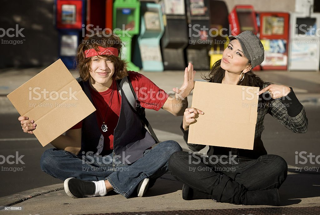 Young Man and Woman with Blank Cardboard Signs royalty-free stock photo