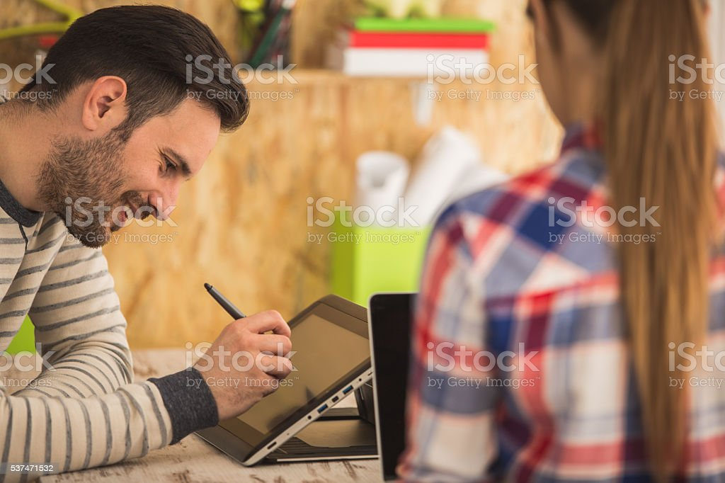 Young man and woman working at modern office stock photo