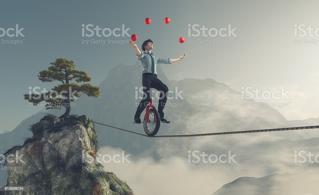 Young man as juggler stock photo