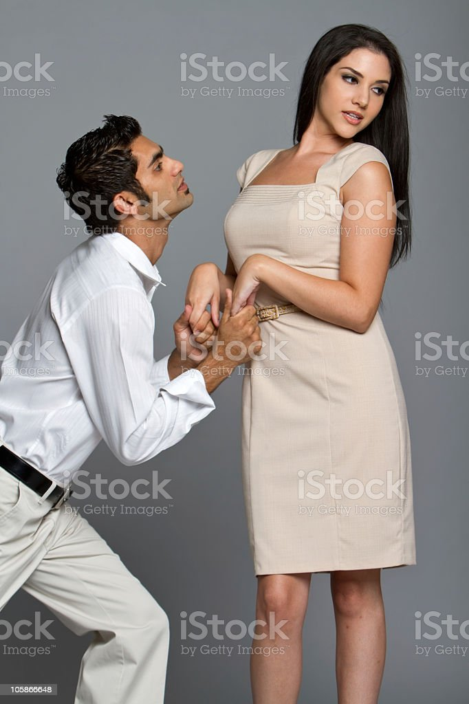 Young man asking forgiveness to his girlfriend royalty-free stock photo