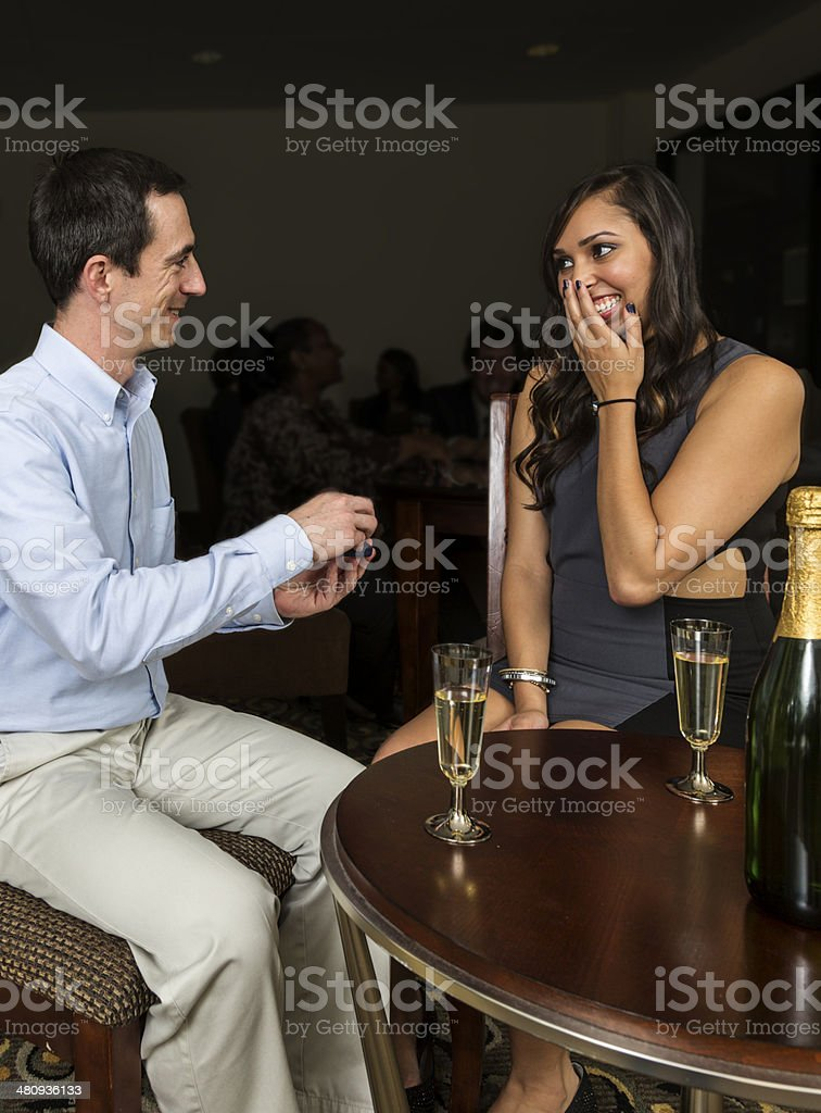 Young man asking his girlfriend to marry him royalty-free stock photo