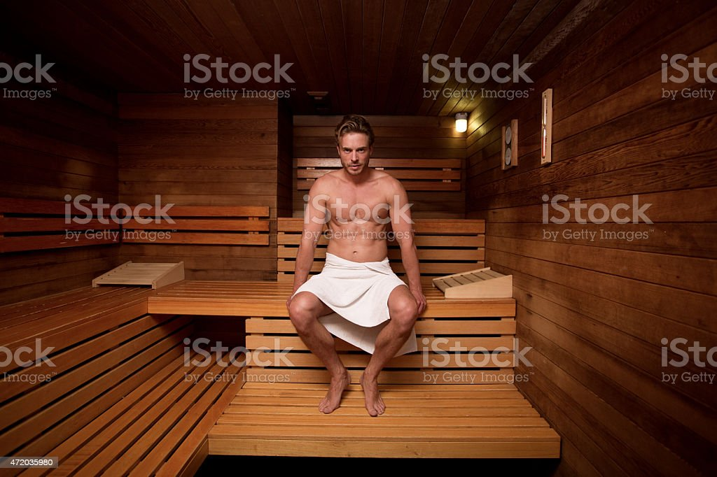 Young man at a gym enjoying a sauna stock photo
