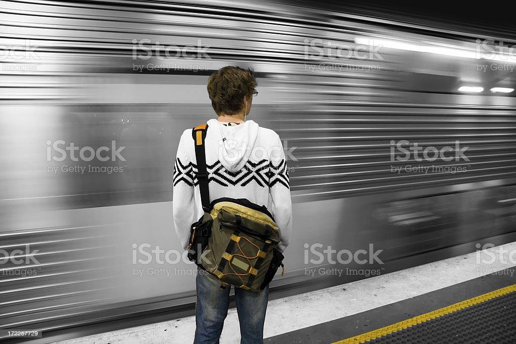 Young man at a train station royalty-free stock photo