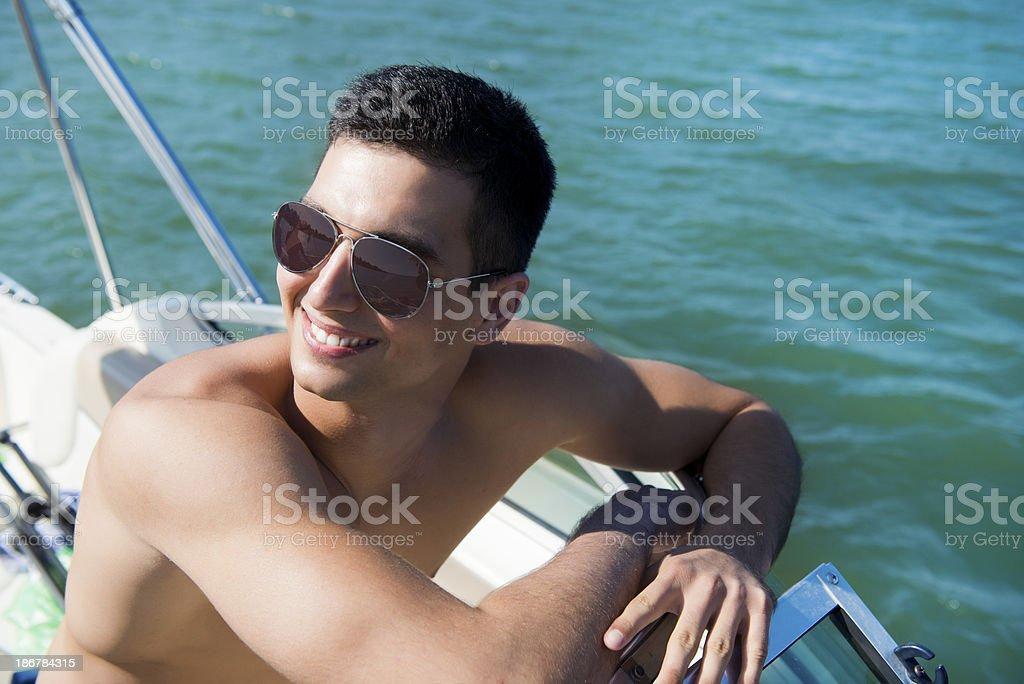 Young man at boat royalty-free stock photo
