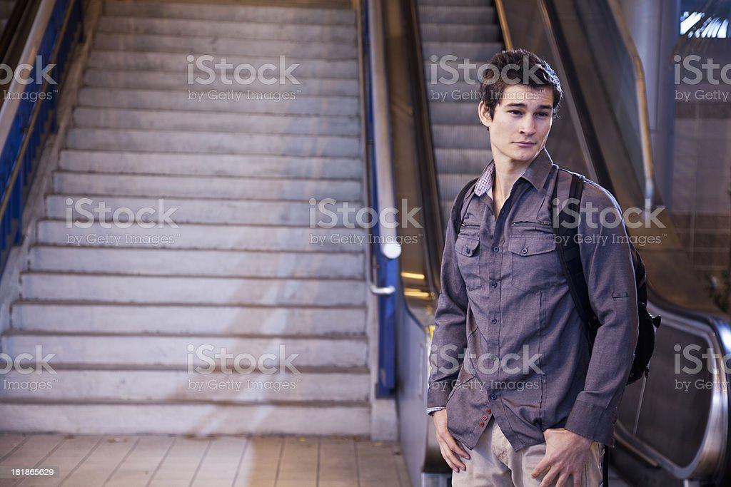 Young man at bottom of stairs stock photo
