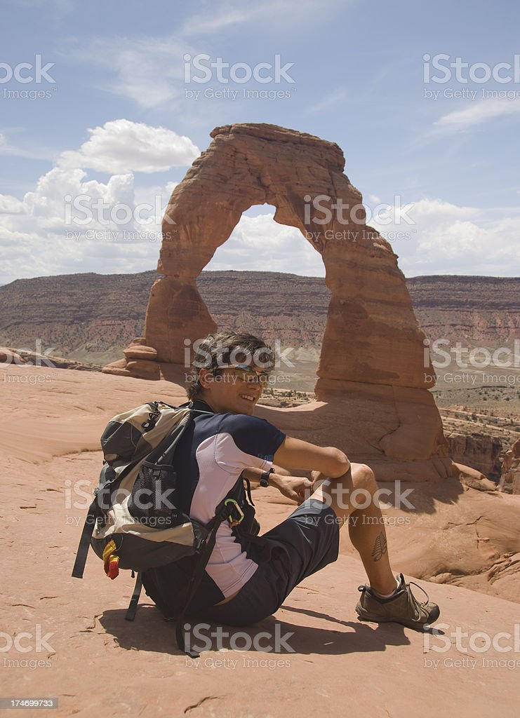 Young Man at Delicate Arch, Arches National Park, Utah stock photo