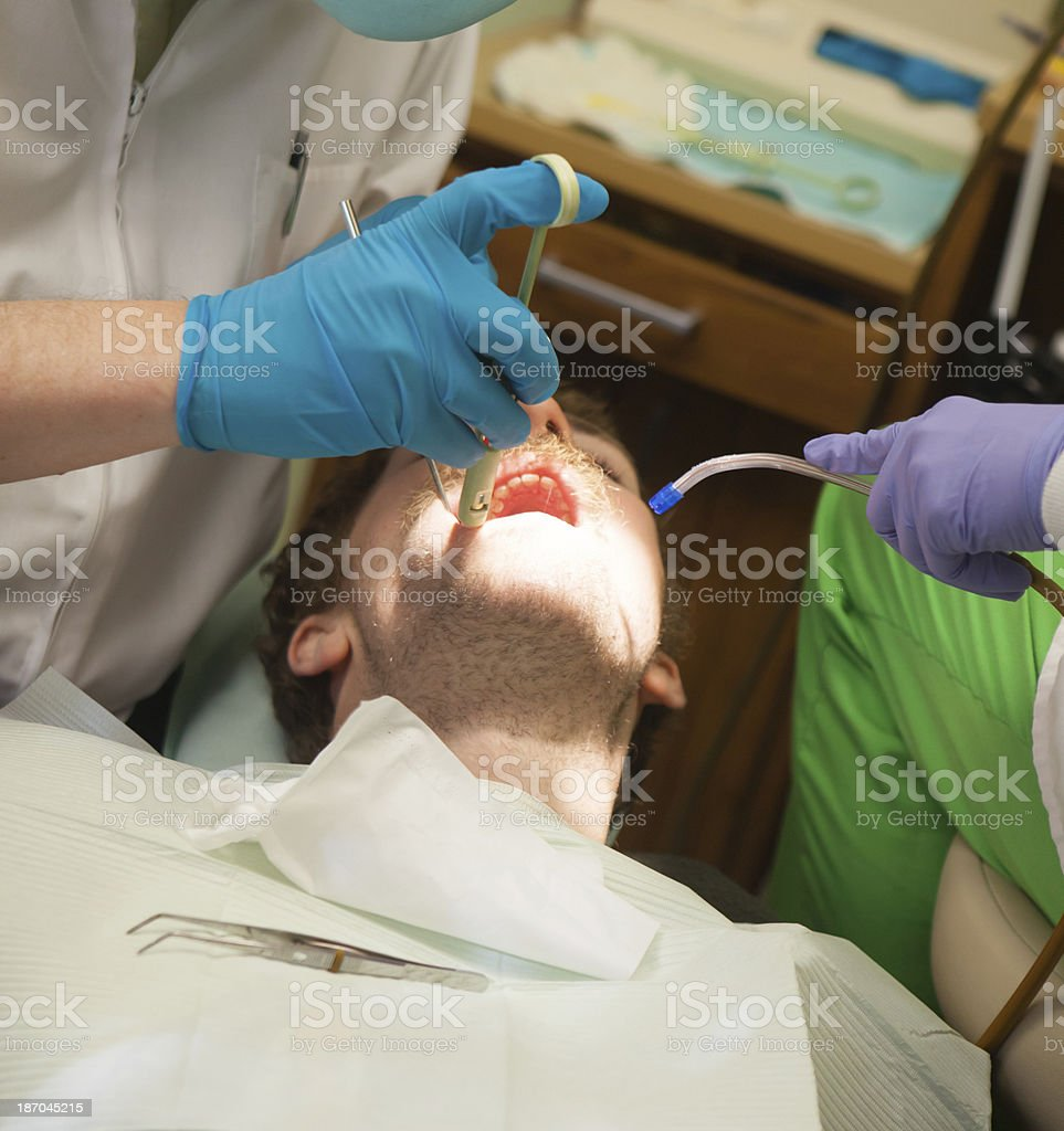 Young man at dentist's having a tooth filled royalty-free stock photo