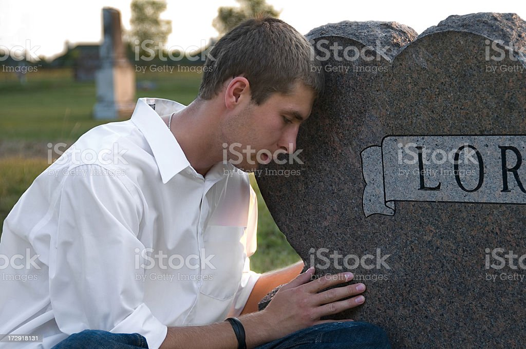 Young Man at Headstone royalty-free stock photo