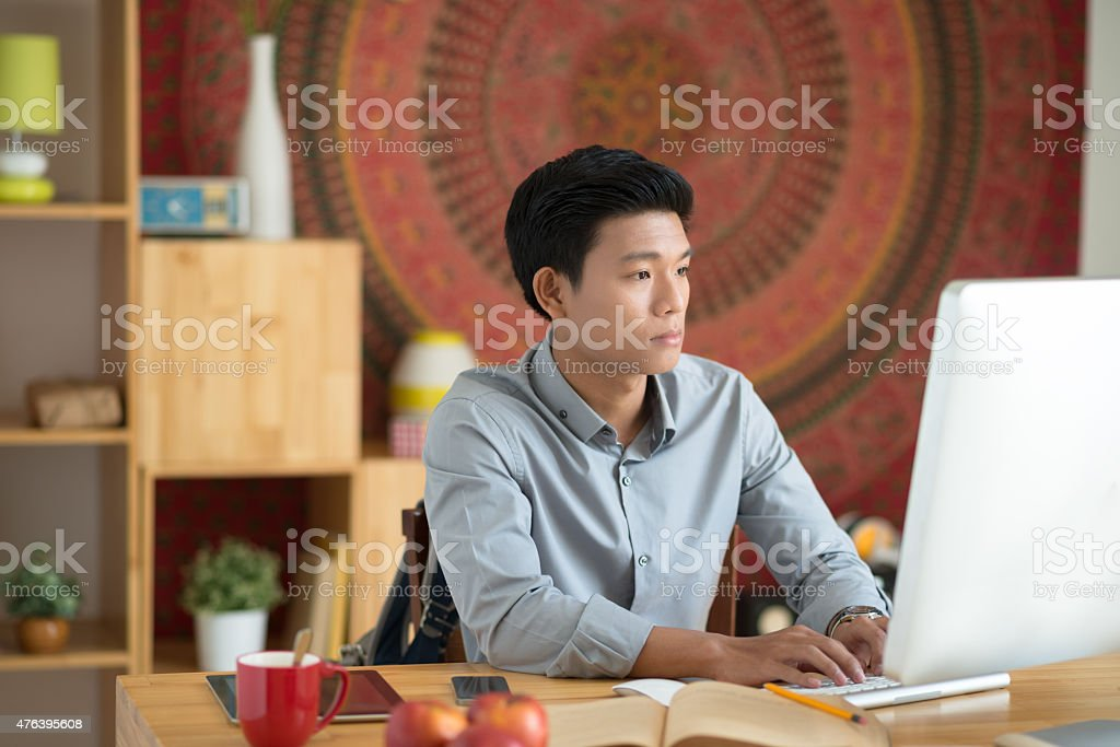 Young man at his workplace stock photo