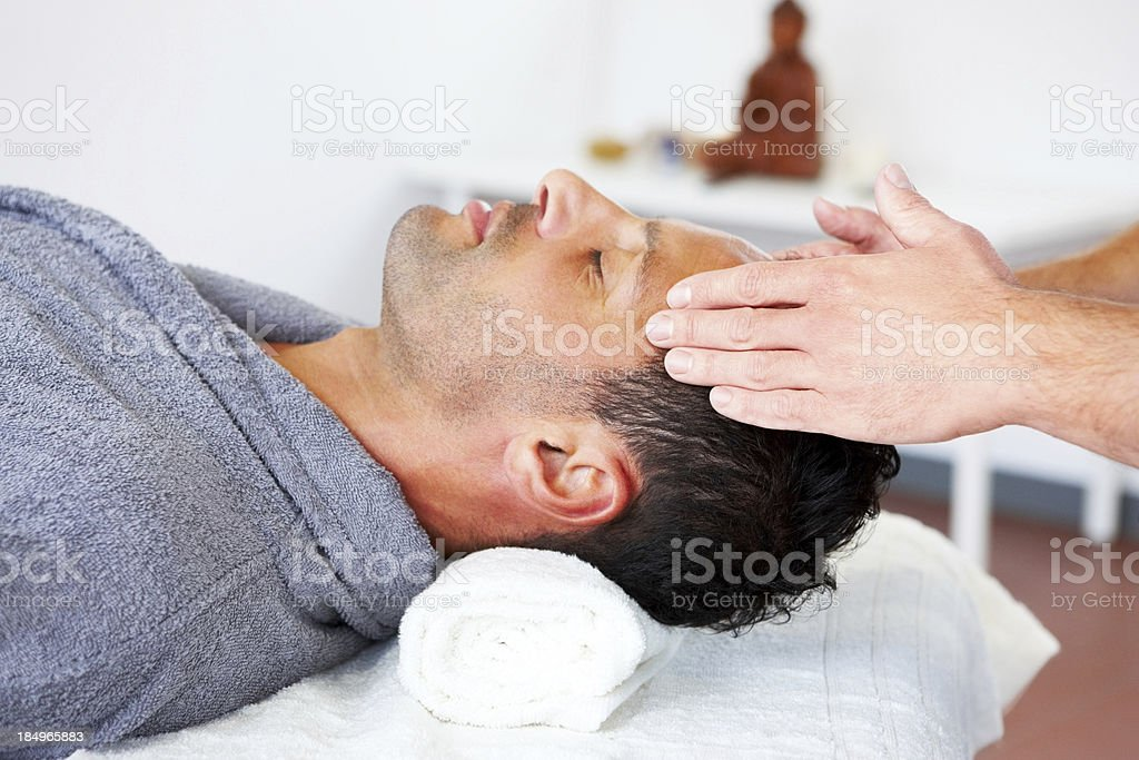 Young man at spa getting a massage stock photo