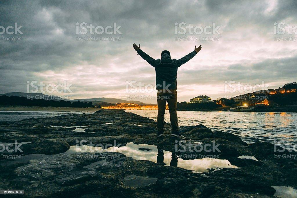 Young man at sunset stock photo