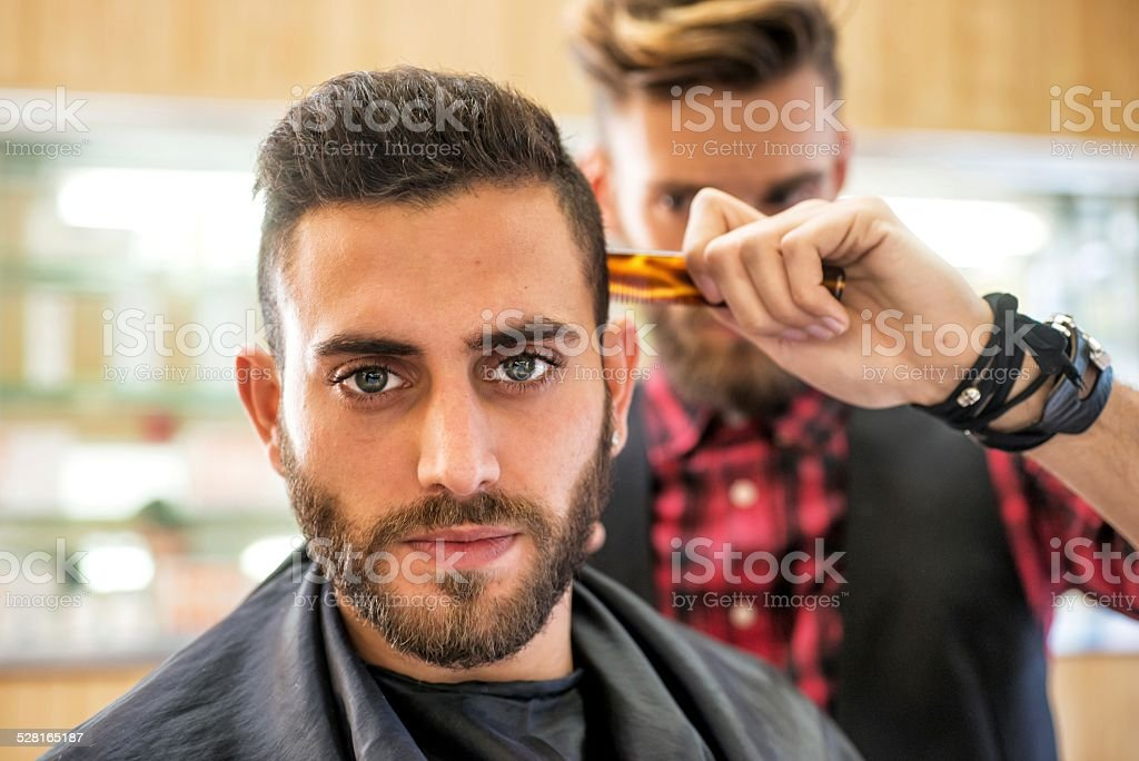 Young Man at the Barber stock photo