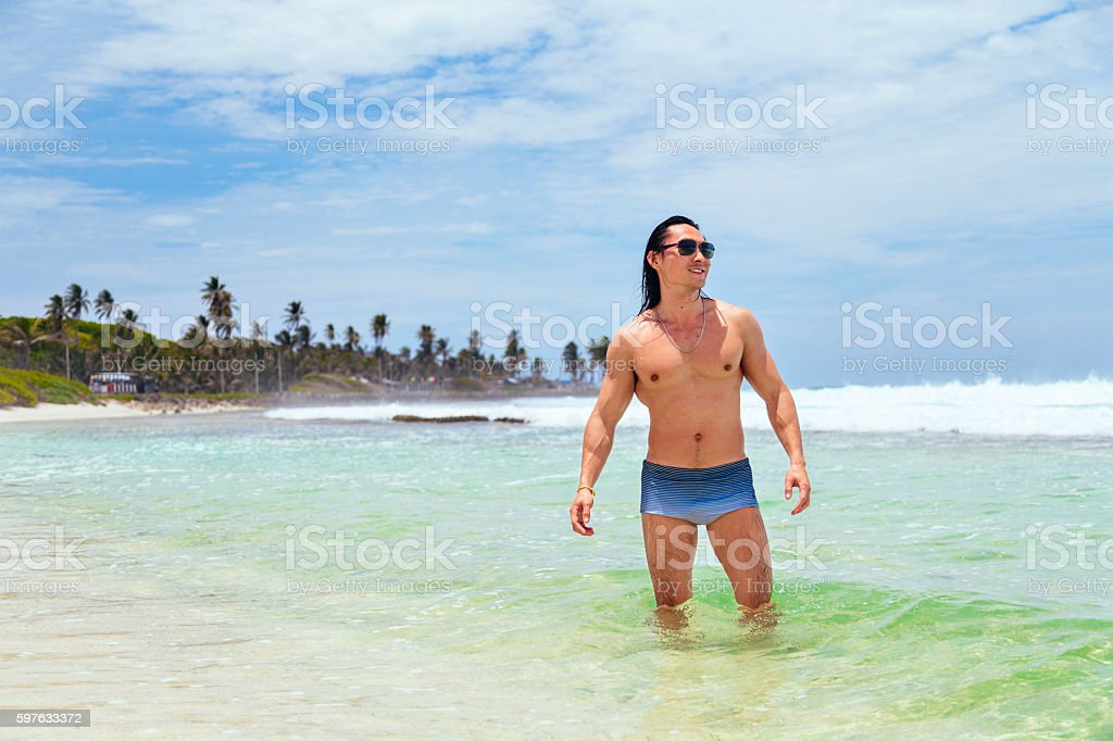 Young man at the beach stock photo