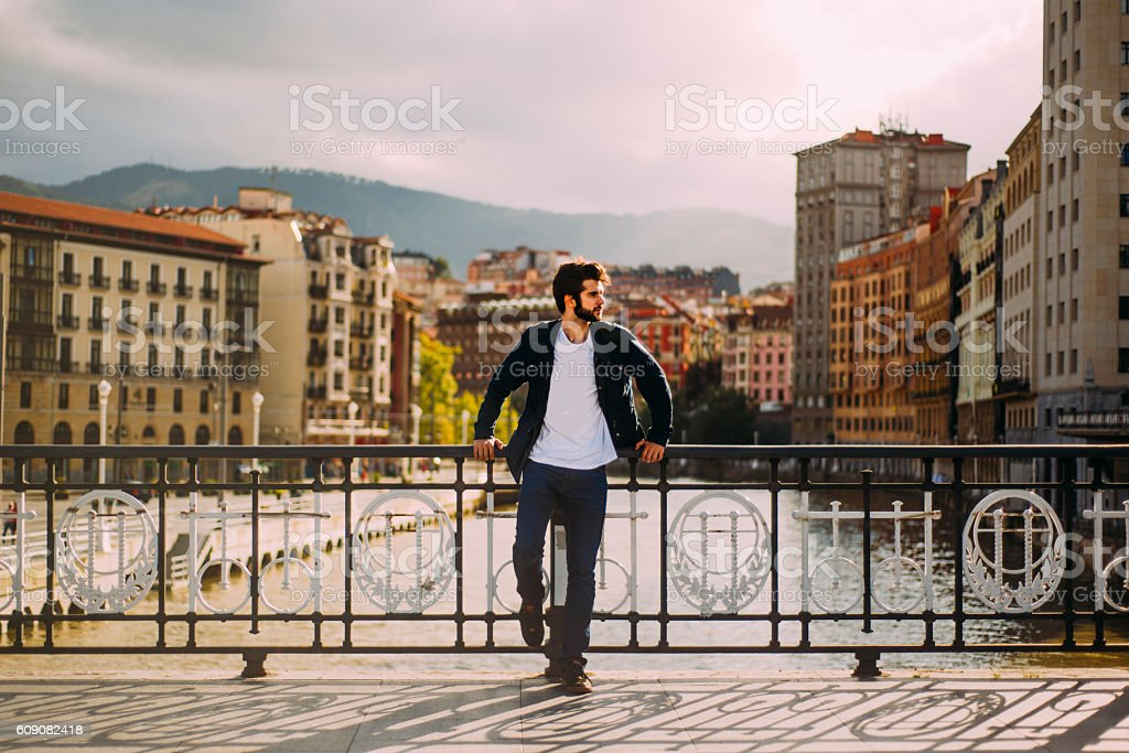 Young man at the city stock photo