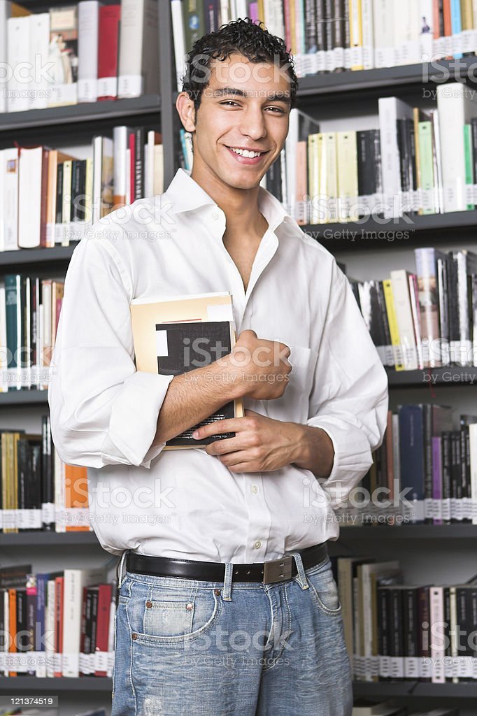 Young man at the library royalty-free stock photo