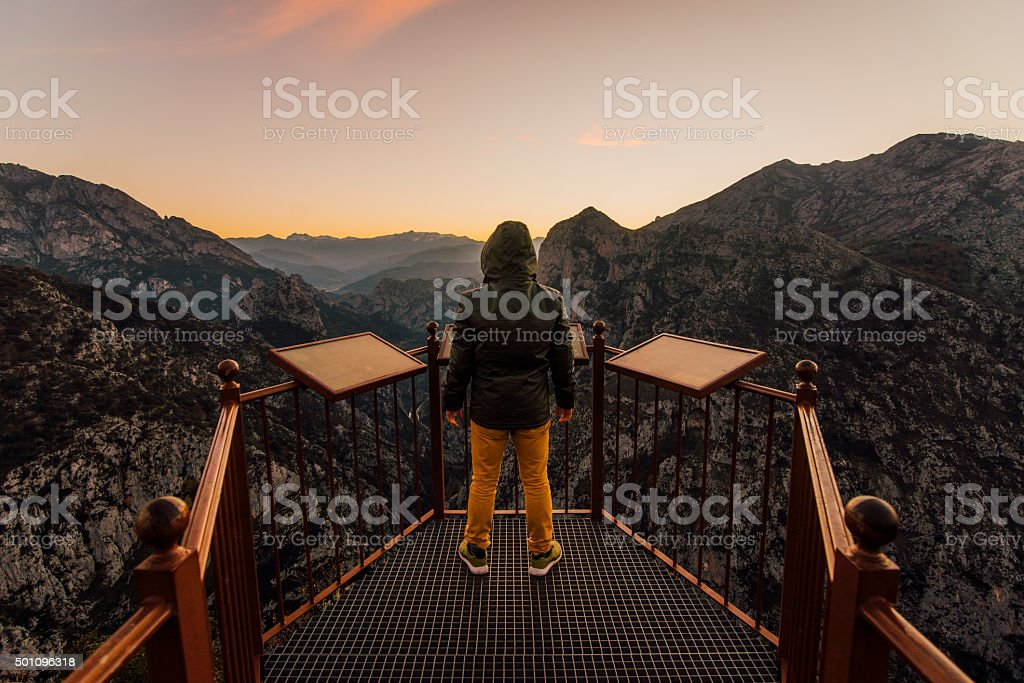 Young man at the mountains stock photo