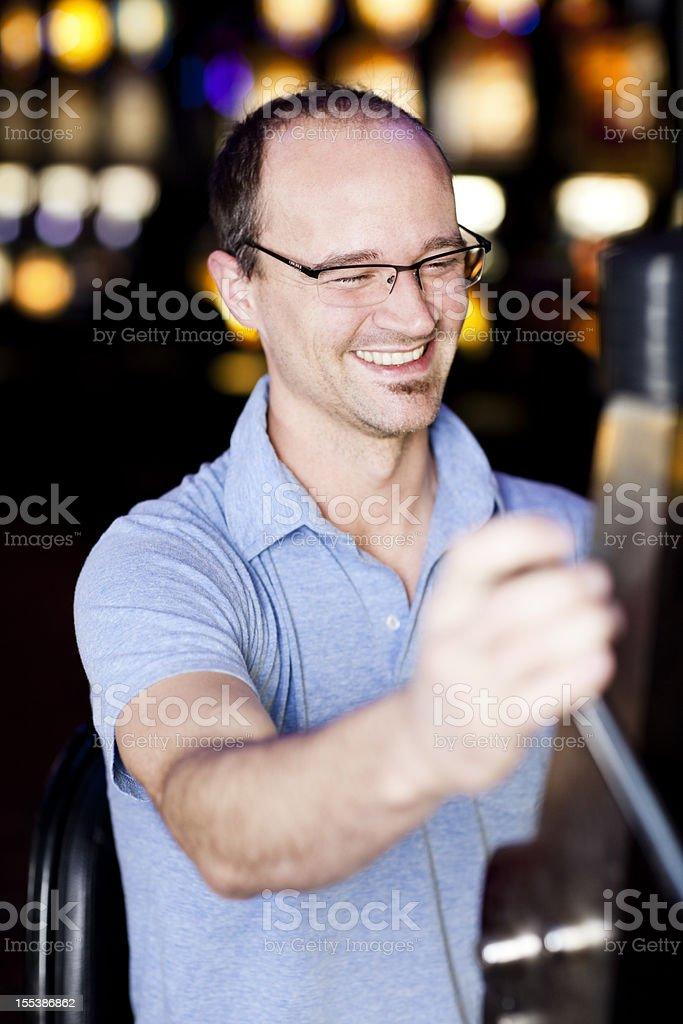 Young man at the slot machine royalty-free stock photo
