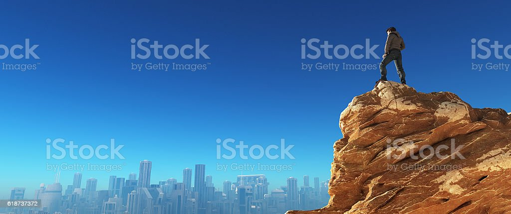 Young man at the top of the stone stock photo