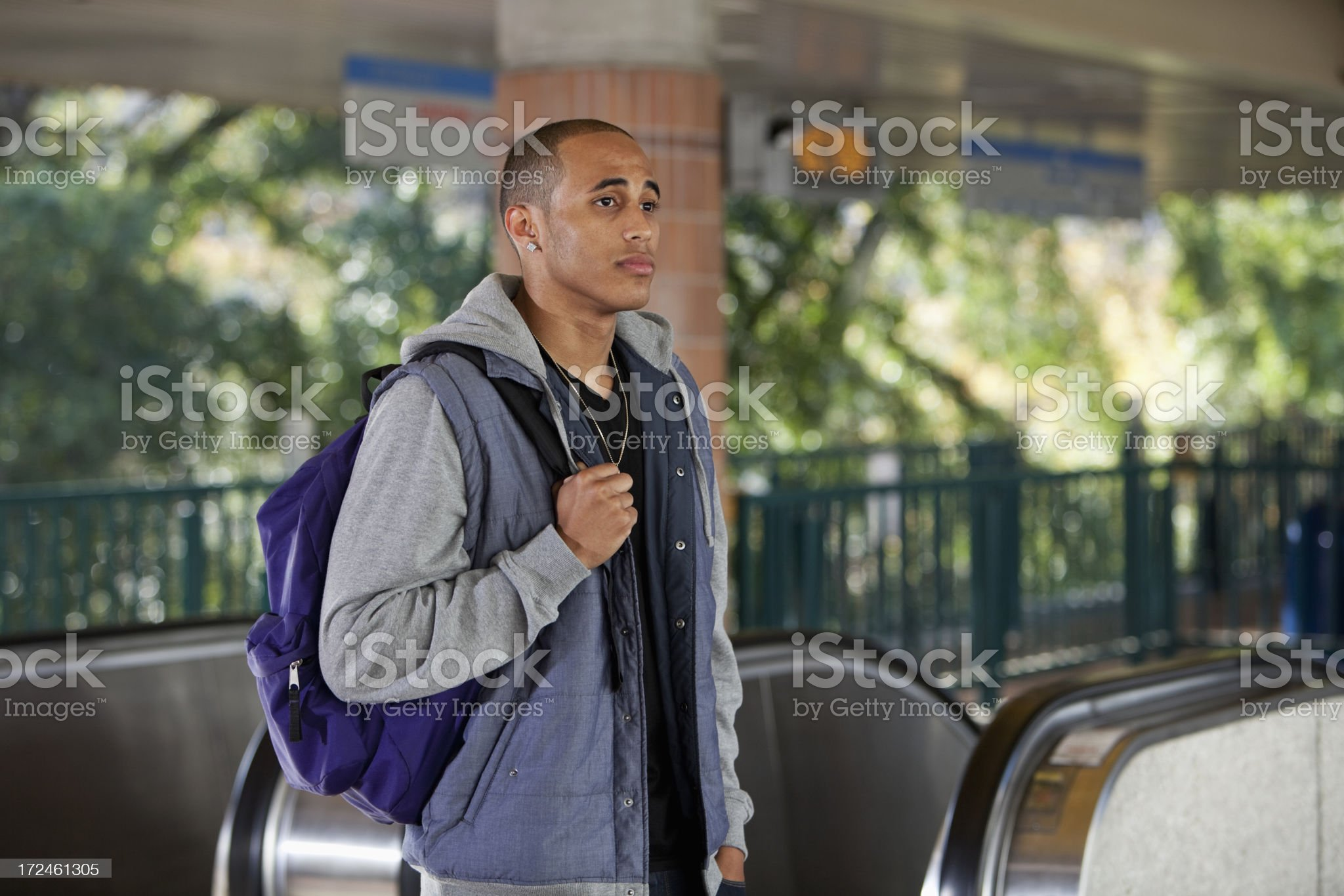Young man at train station royalty-free stock photo