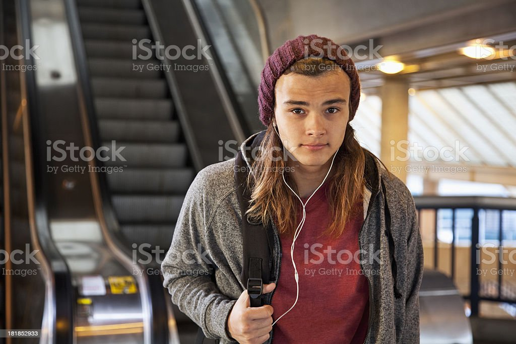 Young man at train station stock photo