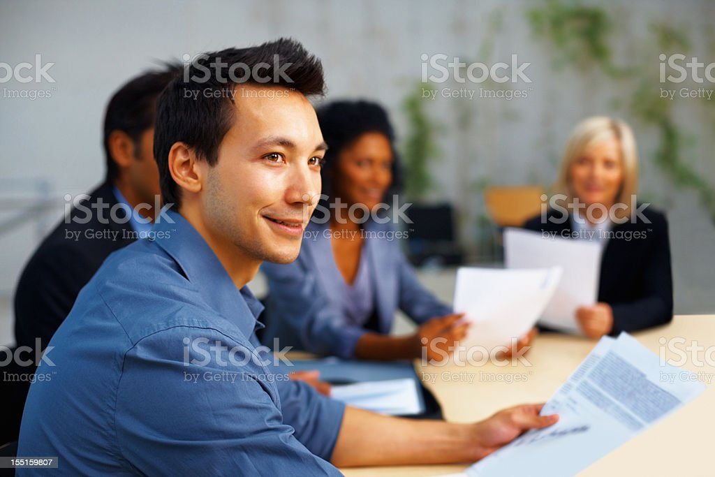 Young man attending business meeting royalty-free stock photo