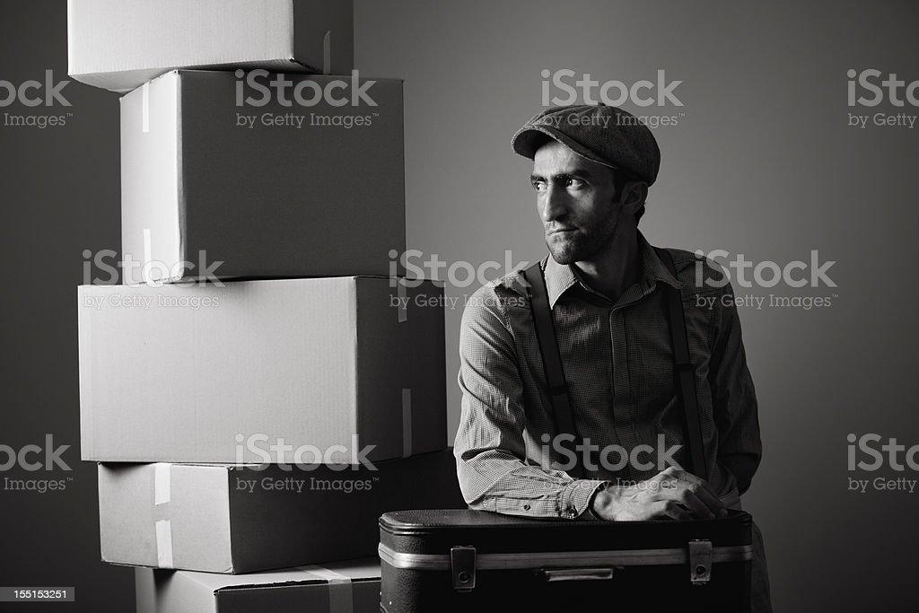 Young man backs away his belongings stock photo