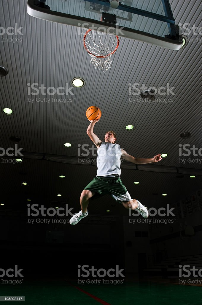 Young Man Basketball Player Dunking royalty-free stock photo