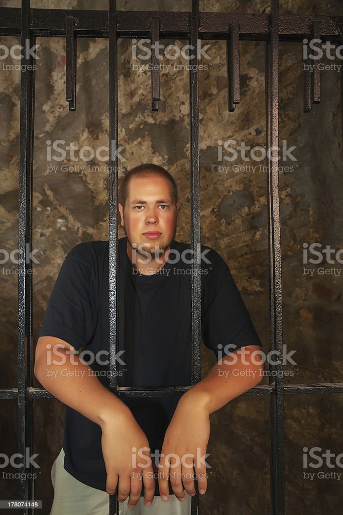 Young man behind the bars royalty-free stock photo