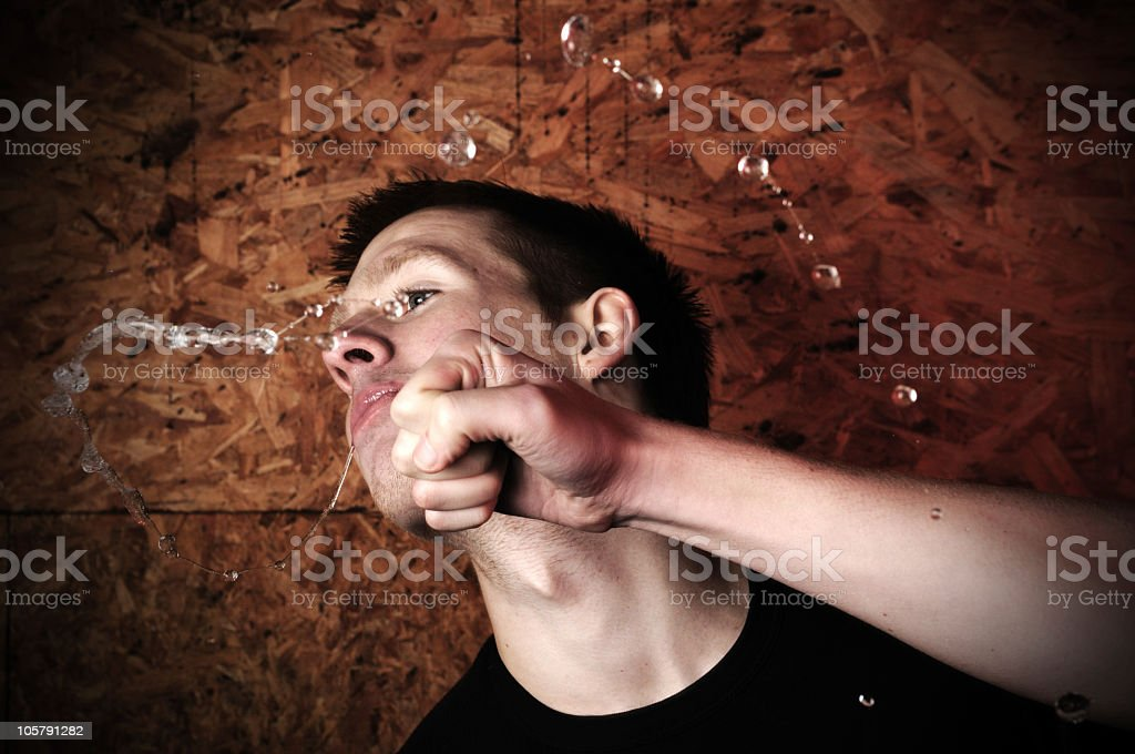 Young man being punched royalty-free stock photo