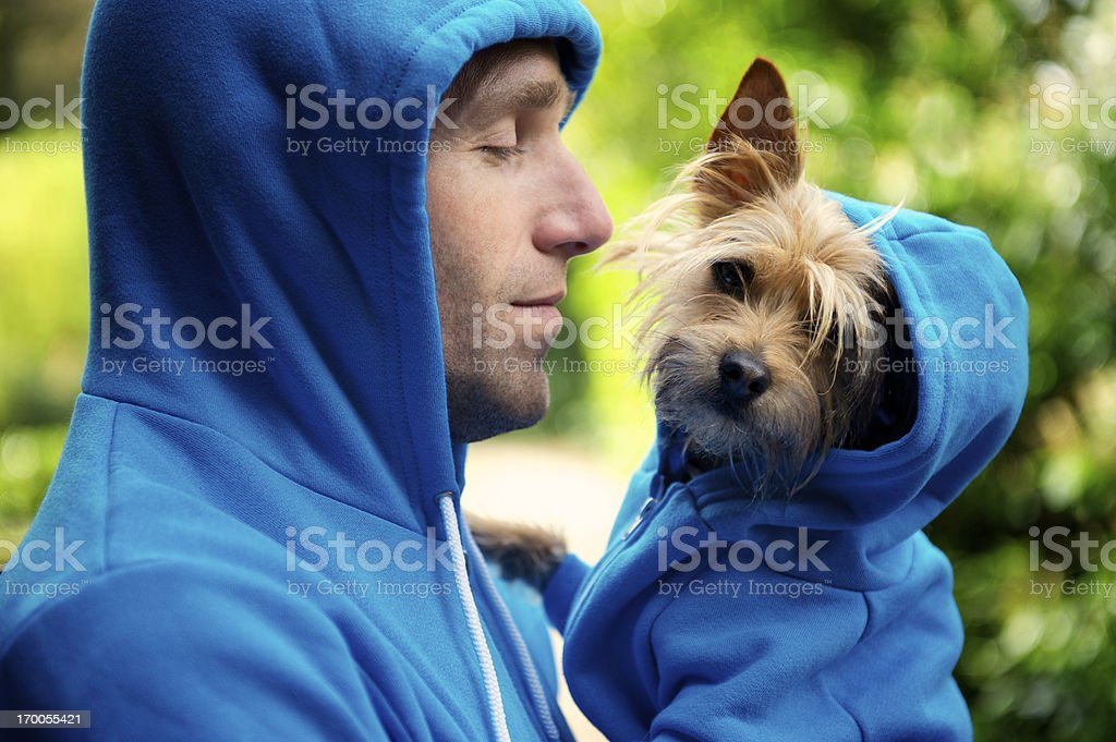 Young Man Best Friend Dog Matching Blue Hoodies Outdoors Park stock photo