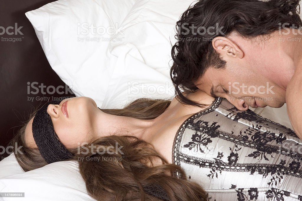 Young Man, blindfolded dead woman stock photo