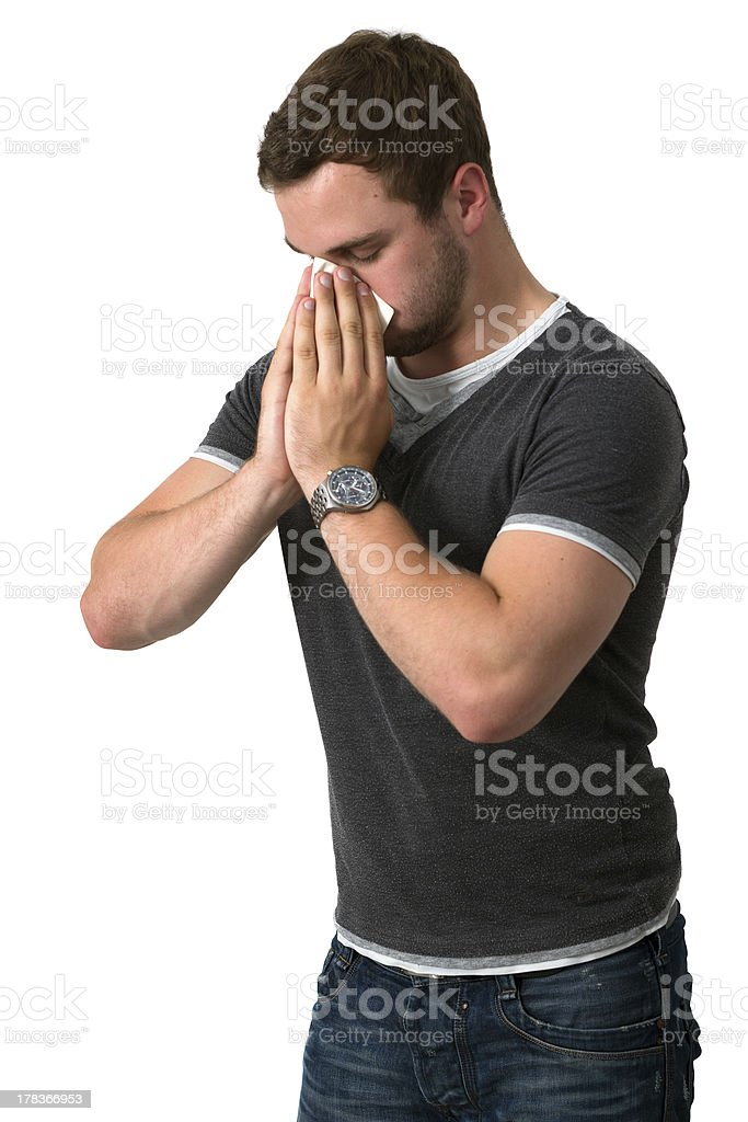 Young Man Blowing Nose royalty-free stock photo