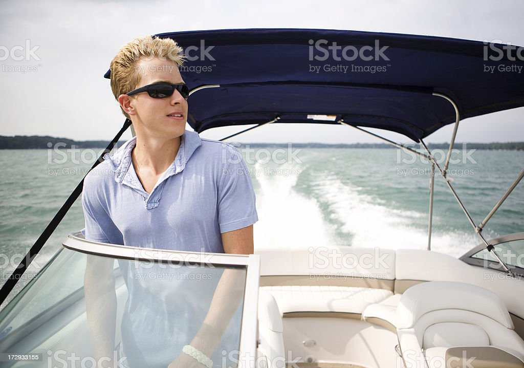 young man boating royalty-free stock photo